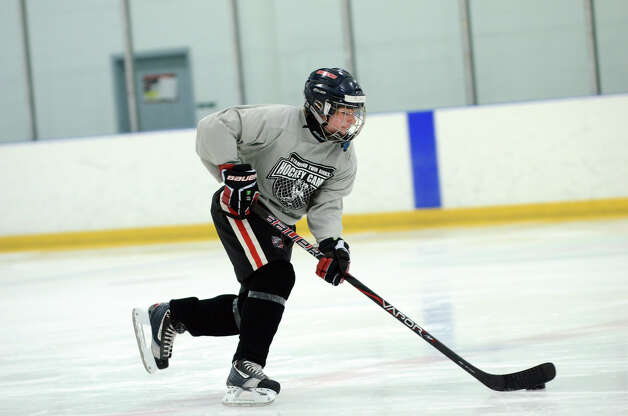 Ryan Hart, of Stamford, practices a drill during the NHL Pee Wee ice hockey camp for students ages 11-12 at the Stamford Twin Rinks on Tuesday, Aug. 7, 2012. The weeklong camp is run by New Canaan's Max Pacioretty of the Montreal Canadiens . Photo: Amy Mortensen / Connecticut Post Freelance