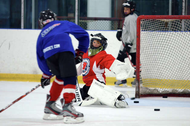 Jacob Schneider, of Ridgefield, defends the goal during the NHL Pee Wee ice hockey camp for students ages 11-12 at the Stamford Twin Rinks on Tuesday, Aug. 7, 2012. The weeklong camp is run by New Canaan's Max Pacioretty of the Montreal Canadiens . Photo: Amy Mortensen / Connecticut Post Freelance