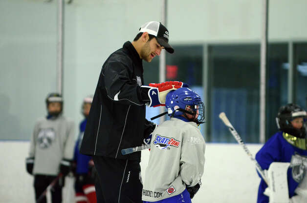 Coach Max Pacioretty talks to student Andrew Smith, of Darien, during the NHL Pee Wee ice hockey camp for students ages 11-12 at the Stamford Twin Rinks on Tuesday, Aug. 7, 2012. The weeklong camp is run by New Canaan's Max Pacioretty of the Montreal Canadiens . Photo: Amy Mortensen / Connecticut Post Freelance