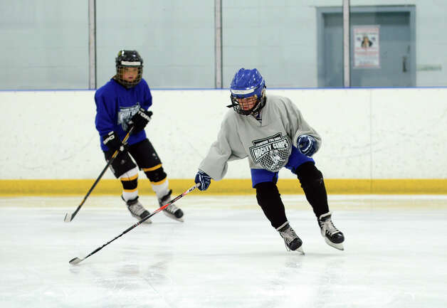 Gavin Foster, of Darien, practices a drill during the NHL Pee Wee ice hockey camp for students ages 11-12 at the Stamford Twin Rinks on Tuesday, Aug. 7, 2012. The weeklong camp is run by New Canaan's Max Pacioretty of the Montreal Canadiens . Photo: Amy Mortensen / Connecticut Post Freelance