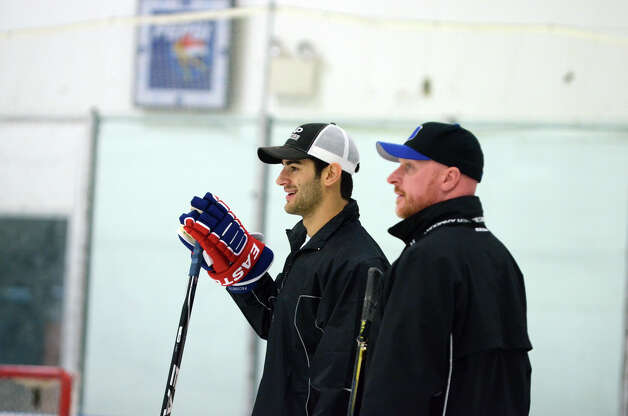 New Canaan's Max Pacioretty of the Montreal Canadiens and Marvin Minkler, Stamford Twin Rinks Assistant Hockey Director, watch students run drills during the NHL Pee Wee ice hockey camp for students ages 11-12 at the Stamford Twin Rinks on Tuesday, Aug. 7, 2012. The weeklong camp is run by New Canaan's Max Pacioretty of the Montreal Canadiens . Photo: Amy Mortensen / Connecticut Post Freelance