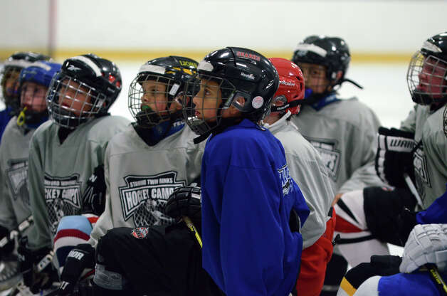 Students listen to instruction during the NHL Pee Wee ice hockey camp for students ages 11-12 at the Stamford Twin Rinks on Tuesday, Aug. 7, 2012. The weeklong camp is run by New Canaan's Max Pacioretty of the Montreal Canadiens . Photo: Amy Mortensen / Connecticut Post Freelance