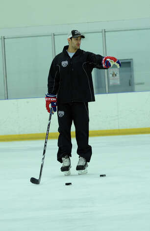 New Canaan's Max Pacioretty of the Montreal Canadiens instructs students during the NHL Pee Wee ice hockey camp for students ages 11-12 at the Stamford Twin Rinks on Tuesday, Aug. 7, 2012. Photo: Amy Mortensen / Connecticut Post Freelance