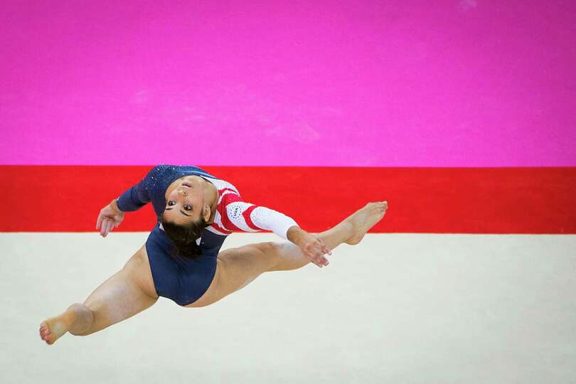 Alexandra Raisman of the USA performs on the floor exercise during the women's gymnastics apparatus