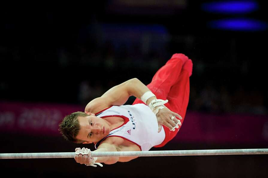 Jonathan Horton of the USA competes in the men's gymnastics horizontal bar final at the 2012 London