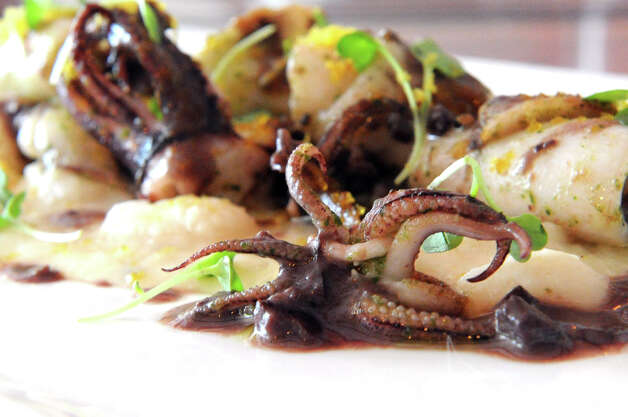 Sauteed squid with cannellini bean pure, bottarga and black olive sauce at Bianco Rosso Wine Bar and Restaurant in Wilton, Conn., July 10, 2012. Photo: Keelin Daly / Stamford Advocate