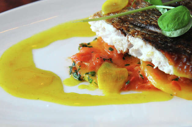 Pan seared red snapper with saffron potatoes, tomatoes, olives, lemon, thyme, garlic and olive oil at Bianco Rosso Wine Bar and Restaurant in Wilton, Conn., July 10, 2012. Photo: Keelin Daly / Stamford Advocate