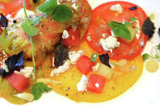 Yellow and red heirloom tomatoes with watermelon, extra virgin olive oil, shallots, goat cheese and opal basil at Bianco Rosso Wine Bar and Restaurant in Wilton, Conn., July 10, 2012. Photo: Keelin Daly / Stamford Advocate
