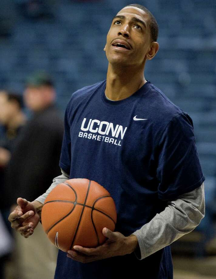 Connecticut assistant coach Kevin Ollie watches practice at the University of Connecticut in Storrs, Conn., Friday, Feb. 3, 2012.  (AP Photo/Jessica Hill) Photo: Jessica Hill, Associated Press / AP2012