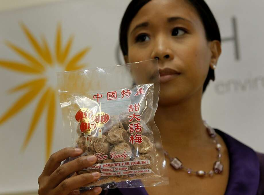 Christine Cordero of the Center for Environmental Health holds plum candy that contains more lead than is allowed. Photo: Brant Ward, The Chronicle