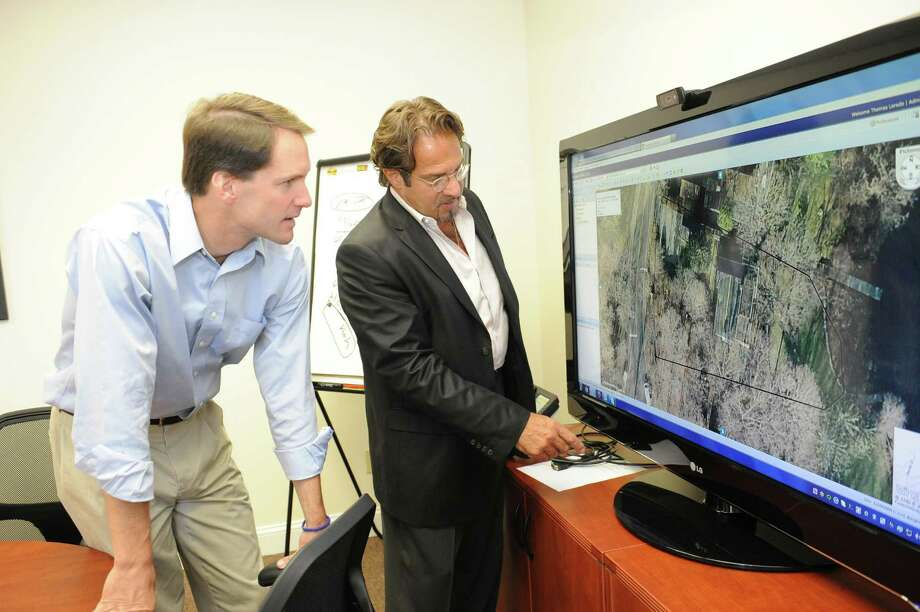 Tom Laredo, right, Renewable Resources director of sales and management, speaks with U.S. Rep Jim Himes about using pictometry to find the right place for a solar pannel. U.S. Rep Jim Himes visits Renewable Resources (Energy Solutions) Inc., in Stamford Tuesday, Aug. 7, 2012. Photo: Helen Neafsey / Greenwich Time