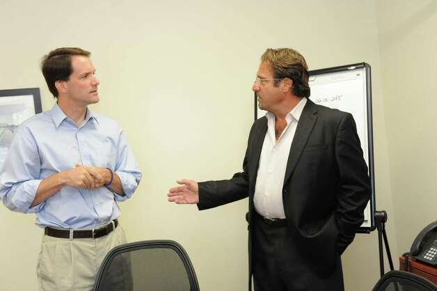 U.S. Rep Jim Himes, left, speaks with Tom Laredo, direct of sales and management of Renewable Resources (Energy Solutions) Inc., in Stamford Tuesday, Aug. 7, 2012. Photo: Helen Neafsey / Greenwich Time
