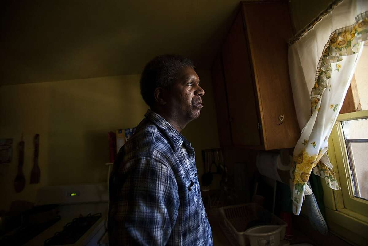 Milton Pitre Jr., 48, of North Richmond, looks out his kitchen window from his home three miles north of the Chevron Richmond Refinery in Richmond, Calif. Tuesday, Aug. 7, 2012. Pitre, who recently had a kidney transplant, experienced difficulties breathing after the refinery's 240,000-barrel-a-day No. 4 crude unit caught fire and released blackened fumes throughout the East Bay.Ê
