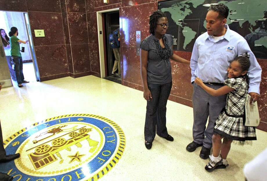 """Chinyere Thompson, 15, and her sister, Asia, 7, say their dad has always taught them to help others. Tuesday was deemed """"Danny Thompson Day"""" for the man who saved two children from a fire. Photo: Melissa Phillip / © 2012 Houston Chronicle"""