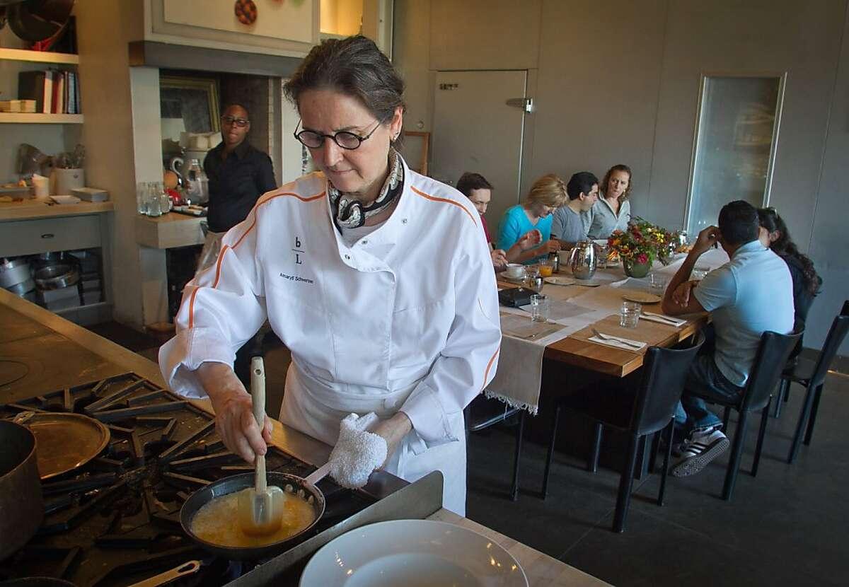 Chef Amaryll Schwertner cooks scrambled eggs for brunch at Boulette's Larder.