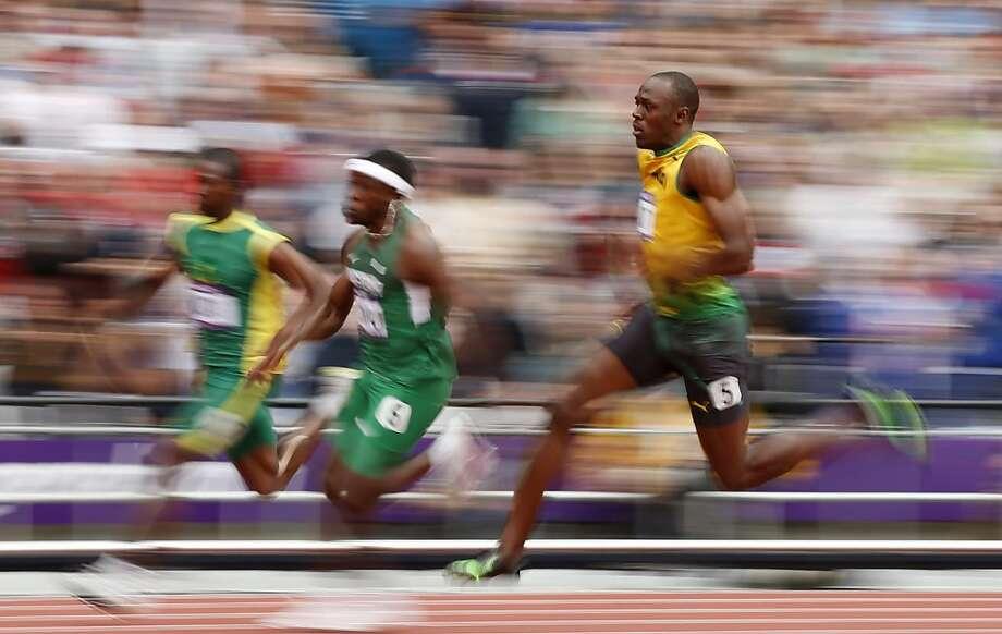 "He made a name for himself in Beijing, and Usain Bolt's fans hope ""Lightning"" will again strike thrice in London. Photo: Matt Dunham, Associated Press"