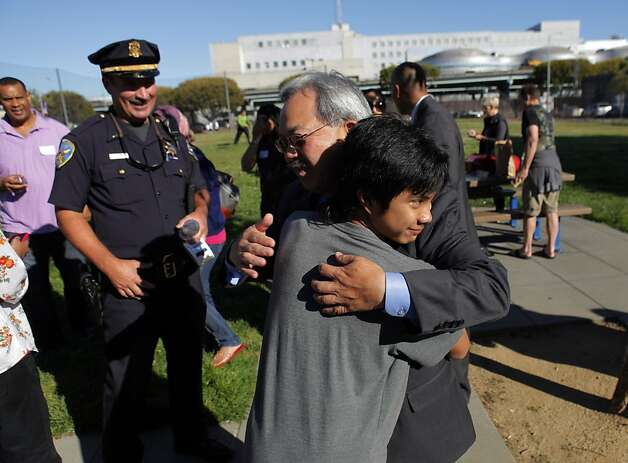 S.F. Mayor Ed Lee gets a hug from Philip Maverick Ruiz during a National Night Out event at SoMa's Victoria Manalo Draves Park. Photo: Carlos Avila Gonzalez, The Chronicle
