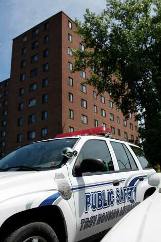 Public safety vehicles sit outside the Troy Housing Authority John P. Taylor Apartment Buildings, pictured Tuesday Aug. 7, 2012 in Troy, N.Y. (Dan Little/Special to the Times Union) Photo: Dan Little / Copyright: All Rights Reserved Brett Carlsen