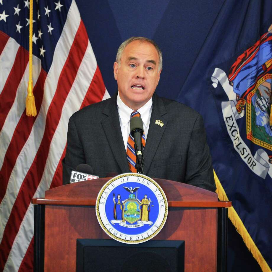 NYS Comptroller Thomas P. DiNapoli announces financial abuses by former Troy Housing Authority officials during a news conference at the  Comptroller's office in Albany Tuesday Aug. 7, 2012.  (John Carl D'Annibale / Times Union) Photo: John Carl D'Annibale / 00018750A