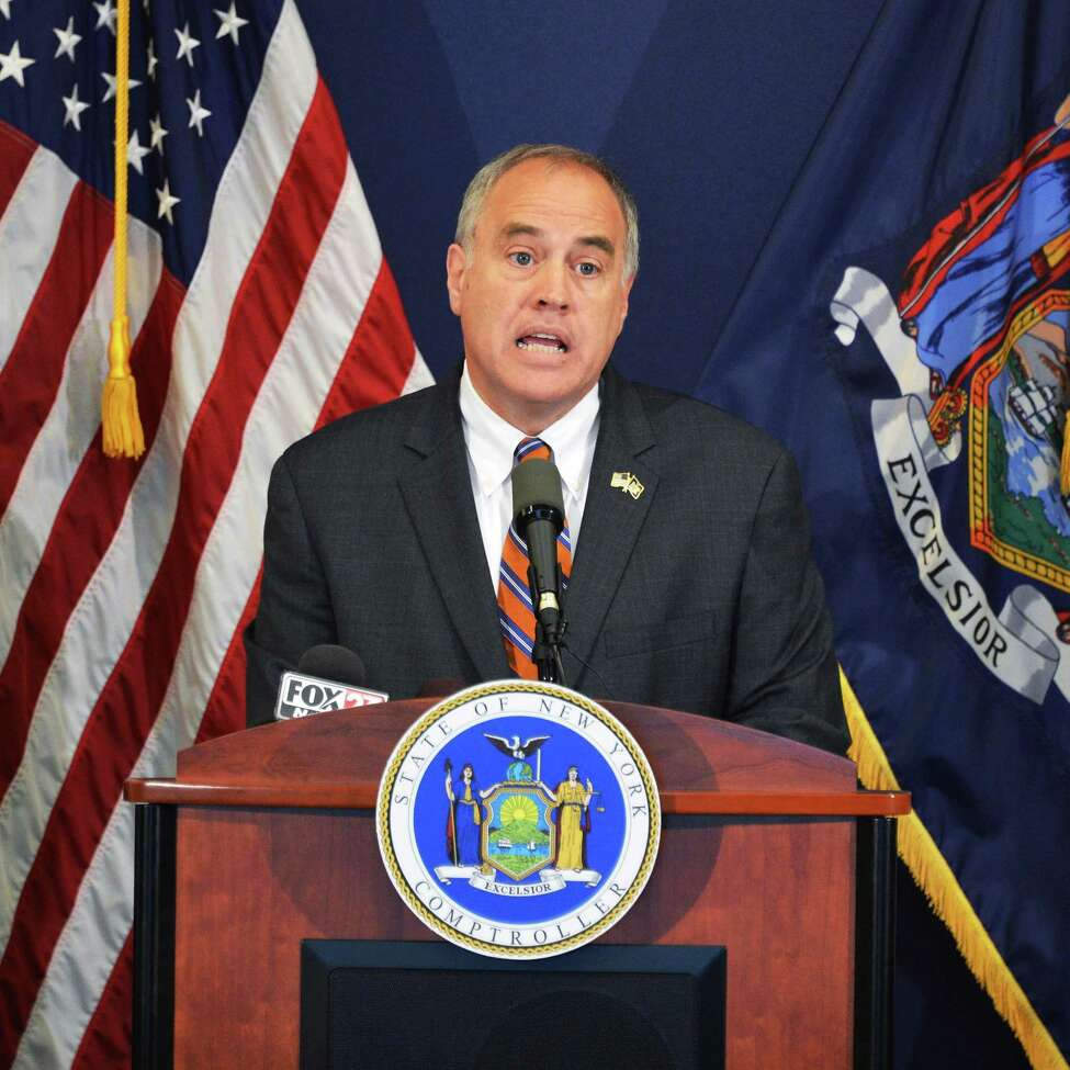 NYS Comptroller Thomas P. DiNapoli announces financial abuses by former Troy Housing Authority officials during a news conference at the Comptroller's office in Albany Tuesday Aug. 7, 2012. (John Carl D'Annibale / Times Union)