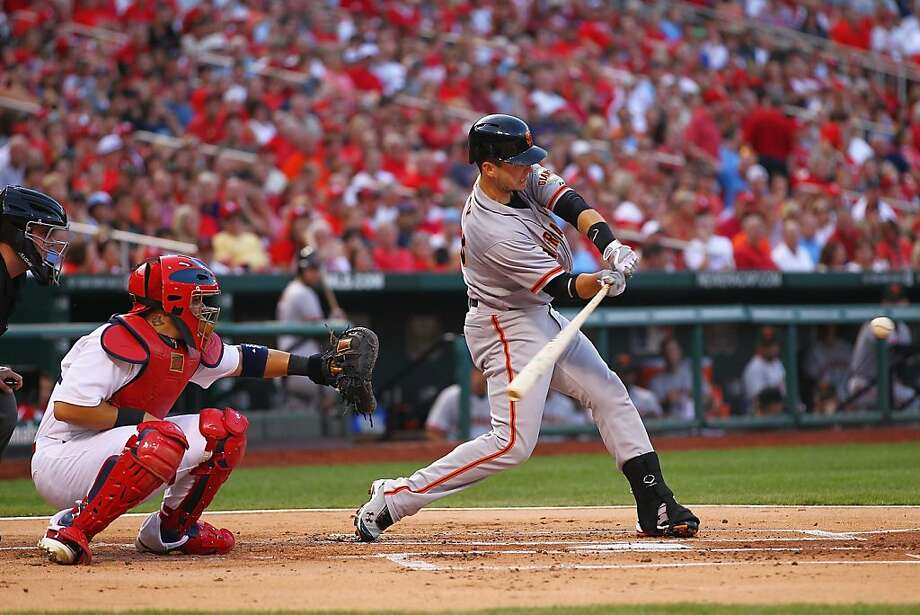 Buster Posey's three-run home run in the first inning was his 12th hit in the first seven days of August. Photo: Dilip Vishwanat, Getty Images