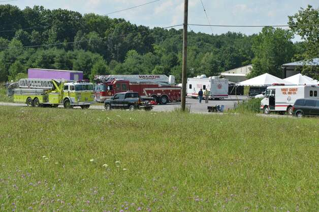 Firefighters staging area on Falls Industrial Park Road near Route 9H in Ghent Thursday Aug. 2, 2012, for a chemical fire at TCI, a transformer recycling company.   (John Carl D'Annibale/ Times Union) Photo: John Carl D'Annibale