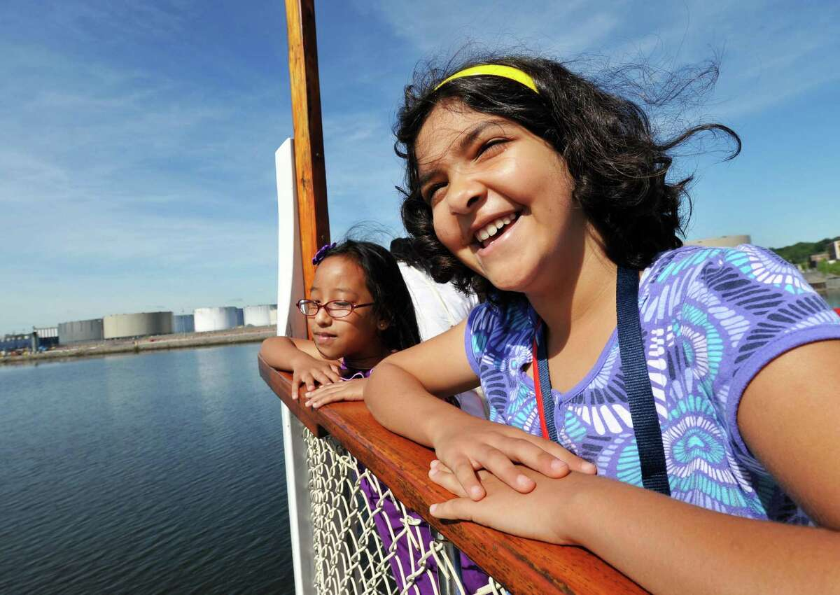 Albany schools' English as a Second Language summer camp students Ngun Fam,9, left, and Zahraa Abdulrazak, 9, during a field trip on a Hudson River cruise aboard the Dutch Apple in Albany Tuesday Aug. 7, 2012. (John Carl D'Annibale / Times Union)