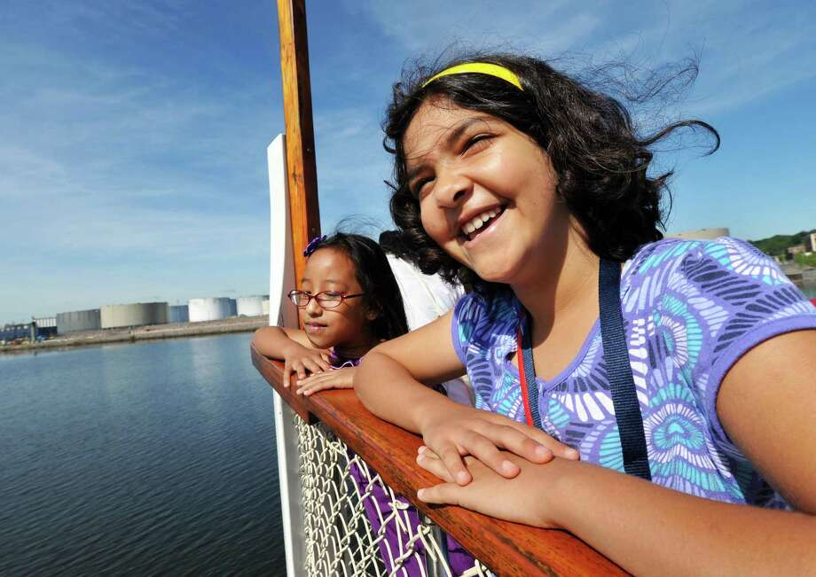 Albany schools' English as a Second Language summer camp students Ngun Fam,9, left, and Zahraa Abdulrazak, 9, during a field trip on a Hudson River cruise aboard the Dutch Apple in Albany Tuesday Aug. 7, 2012.  (John Carl D'Annibale / Times Union) Photo: John Carl D'Annibale / 00018746A