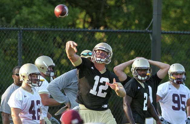Texas State University quarterback Tyler Arndt (12) throws a pass during football practice in San Marcos on Tuesday, August 7, 2012. Photo: Kin Man Hui, San Antonio Express-News / ©2012 San Antonio Express-News