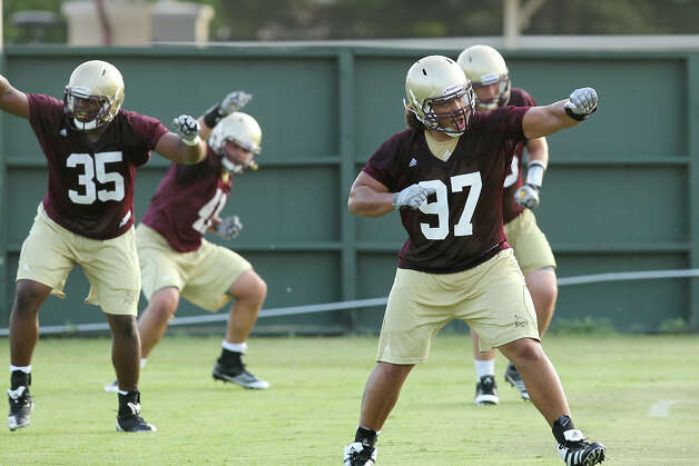 Texas State University's defensive lineman Jordan Norfleet (97) works on drills during the team football practice in San Marcos on Tuesday, August 7, 2012. Photo: Kin Man Hui, San Antonio Express-News / ©2012 San Antonio Express-News