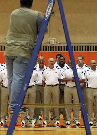 UTSA football head coach Larry Coker (center) joins his staff for photos during the team media day at the Convocation Center on Tuesday, August 7, 2012. The Roadrunners start their season on the road against South Alabama on August 30. Photo: Kin Man Hui, San Antonio Express-News / ©2012 San Antonio Express-News