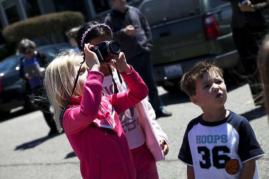 Owen Chee, 4, and his sister Cathrine, 5, are watching the goats arriving at the Presidio Golf Course in San Francisco, Calif. on Tuesday, Aug 07, 2012. Photo: Sonja Och, The Chronicle
