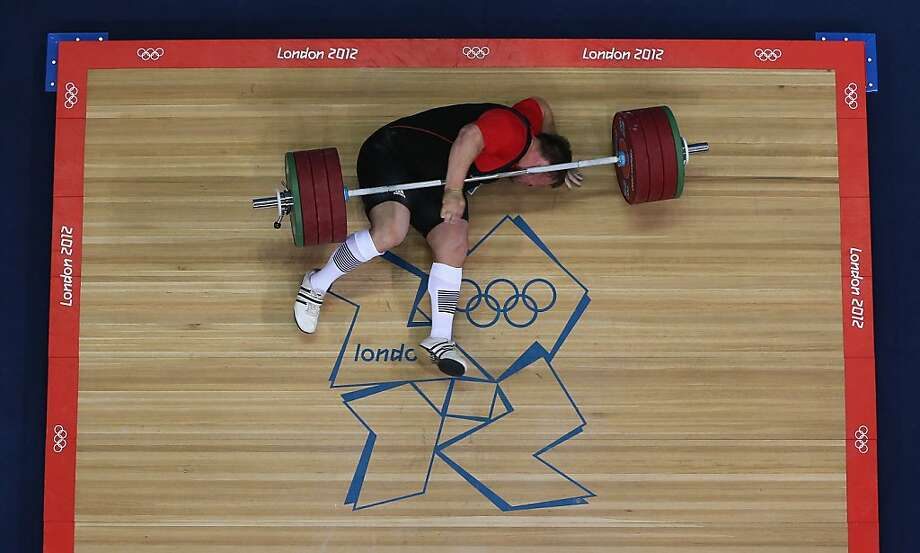 LONDON, ENGLAND - AUGUST 07: Matthias Steiner of Germany lies on the floor after failing to lift in the Men's +105kg Weightlifting final on Day 11 of the London 2012 Olympic Games at ExCeL on August 7, 2012 in London, England.  (Photo by Richard Heathcote/Getty Images) ***BESTPIX*** Photo: Richard Heathcote, Getty Images