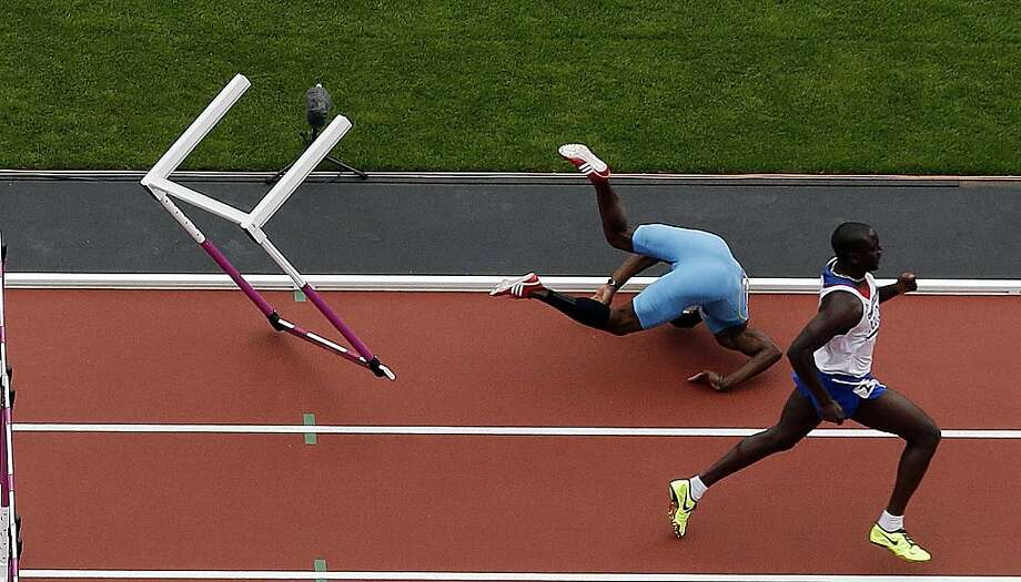 The 100-meter stumble: For the Bahamas' Shamar Sands, the high hurdles were too high and his jump too low. Photo: Morry Gash, Associated Press