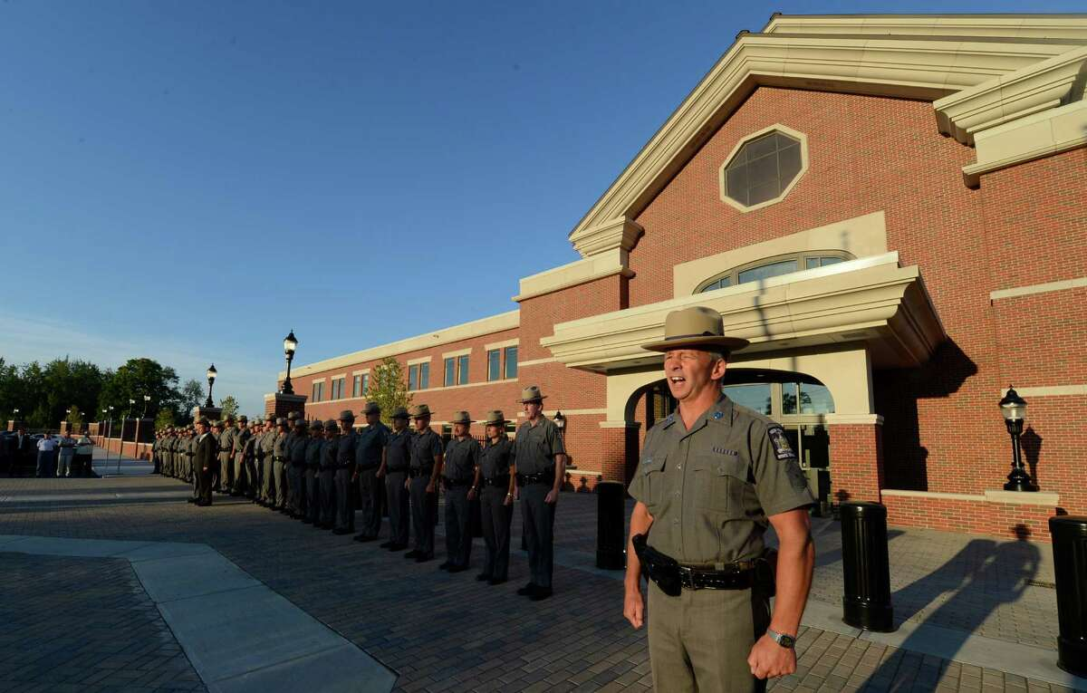 First Sargent Wayne Flores give the command to come to attention during the ceremony to officially open the doors of Troop G's new headquarters in Latham, N.Y. August 8, 2012. (Skip Dickstein/Times Union)