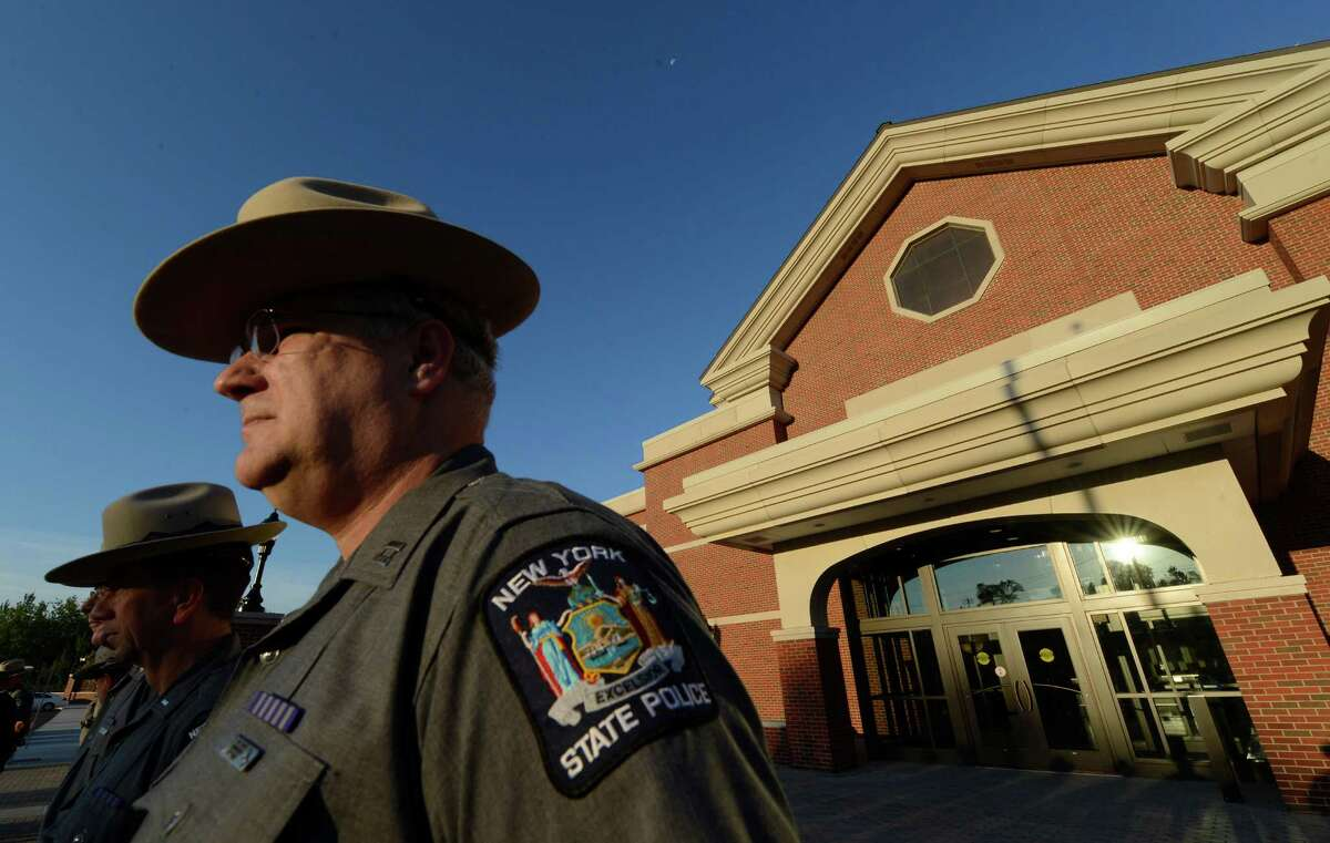 Captain Bill Gavitt stands at attention during the ceremony to officially open the doors of Troop G's new headquarters in Latham, N.Y. August 8, 2012. (Skip Dickstein/Times Union)