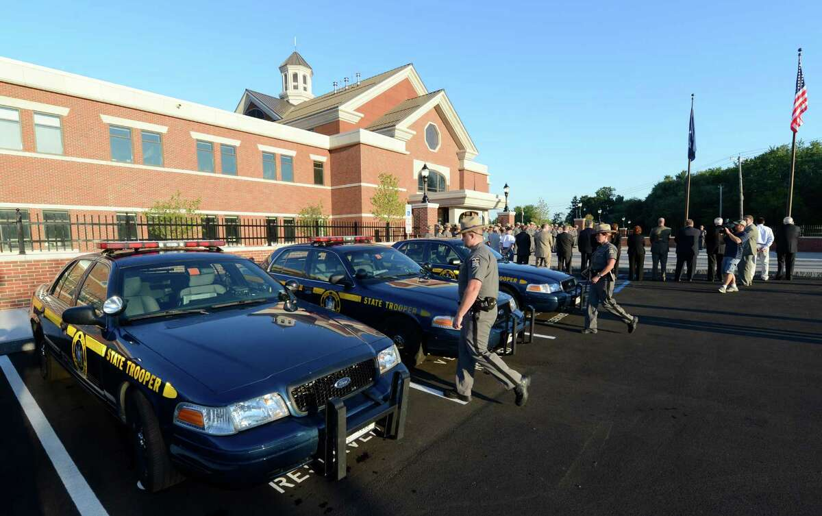 New York State Police troopers go to their cruisers for their first deployment from the new building during the ceremony to officially open the doors of Troop G's new headquarters in Latham, N.Y. August 8, 2012. (Skip Dickstein/Times Union)