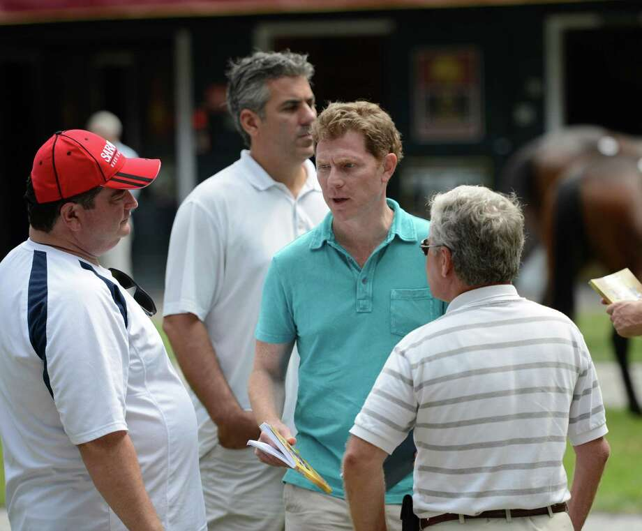 Food Channel personality Bobby Flay speaks to his advisors at the Fasig Tipton Sales grounds in Saratoga Springs, N.Y. August 5, 2012.  Two nights of yearling sales start tomorrow evening in Saratoga. Photo: Skip Dickstein, TIMES UNION