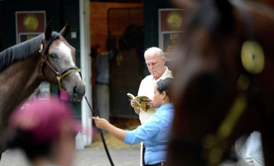 Bloodstock agent Buzz Chase is surrounded with yearlings at the Fasig Tipton Sales grounds in Saratoga Springs, N.Y. August 5, 2012.  Two nights of yearling sales start tomorrow evening in Saratoga. Photo: Skip Dickstein, TIMES UNION