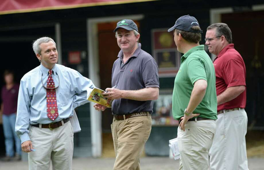 John Fergeson, advisor to Sheik Mohammed speaks with Mark Taylor, left of Taylor Made Sales as he looks over yearlings at the Fasig Tipton Sales grounds in Saratoga Springs, N.Y. August 5, 2012.  Two nights of yearling sales start tomorrow evening in Saratoga. Photo: Skip Dickstein, TIMES UNION