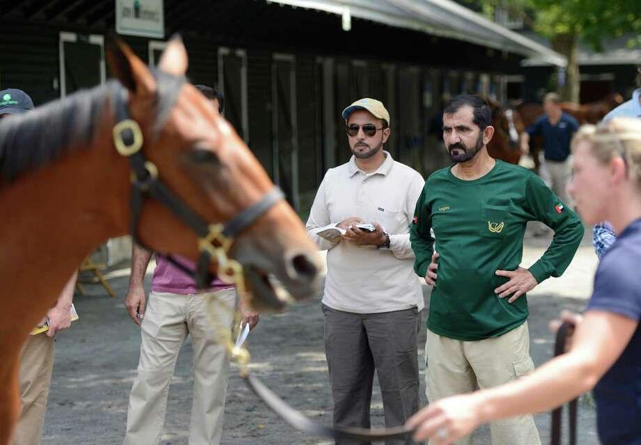 His Highness Sheikh Mohammed bin Rashid Al Maktoum, right inspects, yearlings at the Fasig Tipton Sales grounds in Saratoga Springs, N.Y. August 5, 2012.  Two nights of yearling sales start tomorrow evening in Saratoga. Photo: Skip Dickstein, TIMES UNION