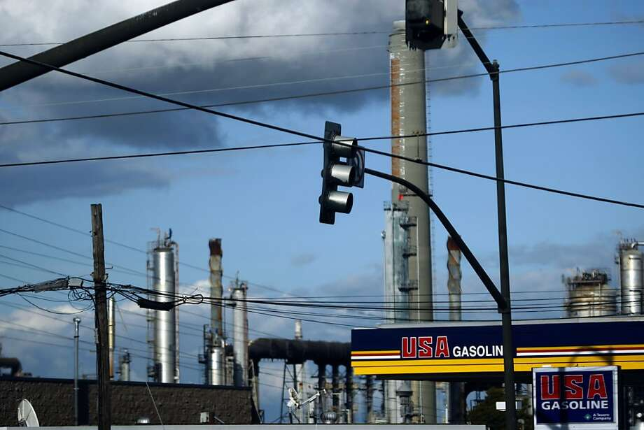 In this 2009 file photo, the Shell refinery in Martinez sits behind a gas station. Photo: Lance Iversen, The Chronicle