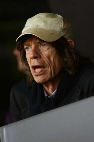 Mick Jagger attends a track and field event at the Olympic Stadium during the London 2012 Olympic Games. (Johannes Eiselejohannes/Getty) (JOHANNES EISELE / AFP/Getty Images)