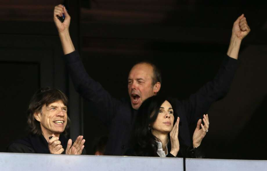 Mick Jagger, left, watches a track and field event with L'Wren Scott, right, in the Olympic Stadium at the 2012 Summer Olympics, Monday, Aug. 6, 2012, in London. (AP Photo/Matt Slocum) (Matt Slocum / Associated Press)