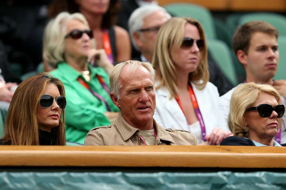 Golfer Greg Norman and his wife Kirsten Kutner (L) watch the Men's Singles Tennis match between Andy Murray of Great Britain and Stanislas Wawrinka of Switzerland. (Photo by Clive Brunskill/Getty Images) (Clive Brunskill / Getty Images)