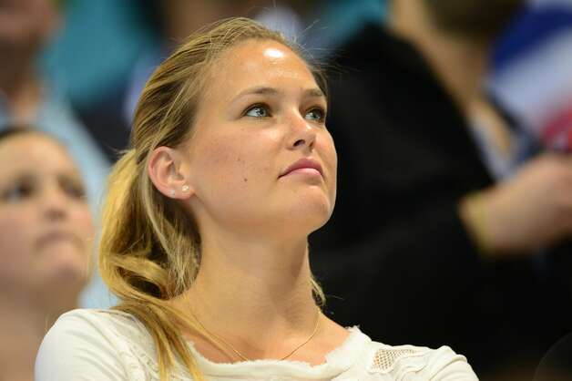 Israeli model Bar Refaeli is seen in the stands during the women's 4x200m freestyle relay final swimming event. (Martin Bureaumartin/Getty) (MARTIN BUREAU / AFP/Getty Images)