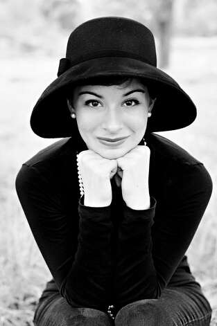 The celebrity I have been told I most resemble is Audrey Hepburn.  Especially after I cut my hair like hers, people always tell me that I look like her. I also have a very classic style, very 40s, 50s, and early 60s based, just as she did. -- Sarah Fernandez Photo: Sarah Fernandez, Reader Submissi