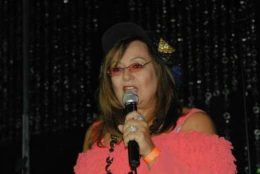 Here's a pic of me doing standup comedy in Las Vegas.  I've had people telling me I look like Roseanne Barr since the late '80s when her show was hugely popular.  As a matter of fact, I saw her when she was here in Connecticut where I live last week campaigning for President of the USA! -- Anne Kissel Photo: Anne Kissel, Reader Submission