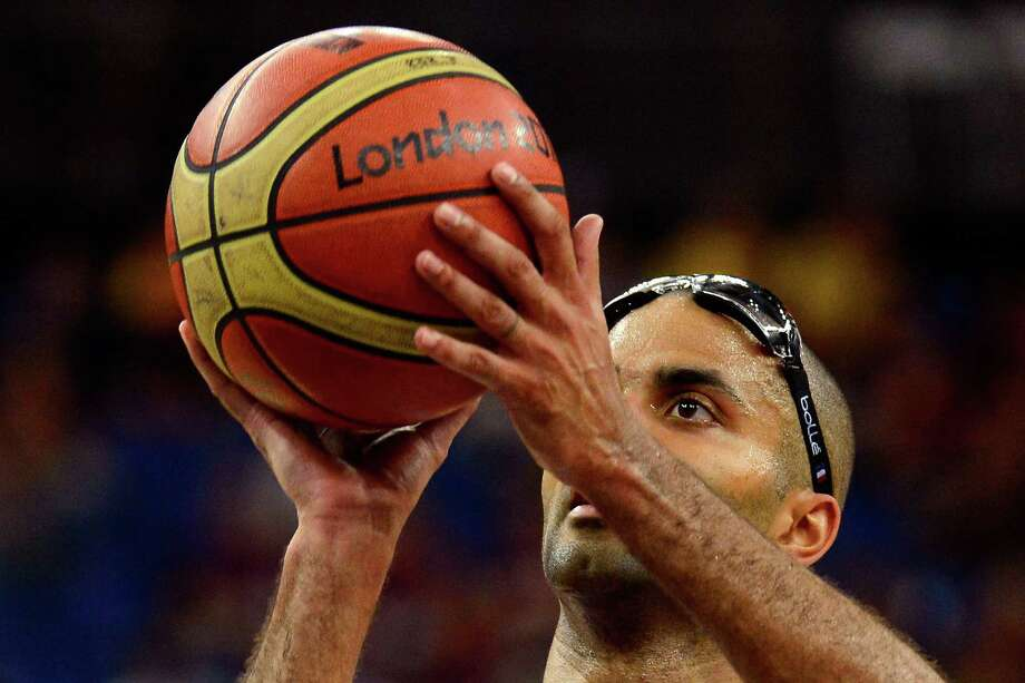 LONDON, ENGLAND - AUGUST 08:  Tony Parker #9 of France shoots a free throw while taking on Spain during the Men's Basketball quaterfinal game on Day 12 of the London 2012 Olympic Games at North Greenwich Arena on August 8, 2012 in London, England. Photo: Ronald Martinez, Getty Images / 2012 Getty Images