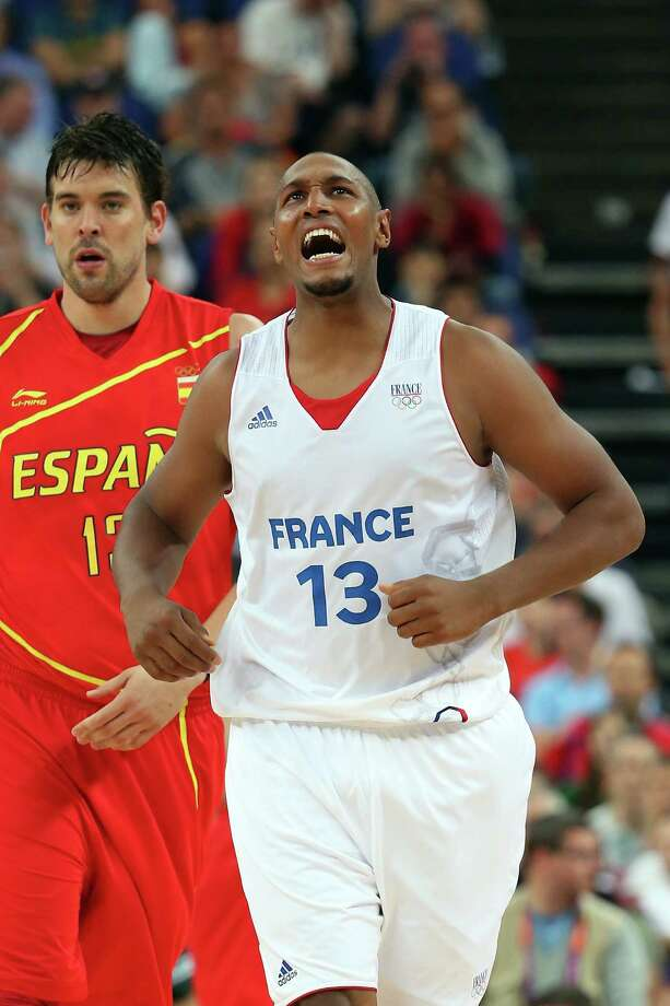 LONDON, ENGLAND - AUGUST 08:  Boris Diaw #13 of France reacts alongside Marc Gasol #13 of Spain in the second half during the Men's Basketball quaterfinal game on Day 12 of the London 2012 Olympic Games at North Greenwich Arena on August 8, 2012 in London, England. Photo: Christian Petersen, Getty Images / 2012 Getty Images
